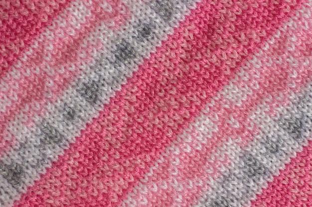 Tessuto a maglia con motivo, fatto a mano. sfondo, trama