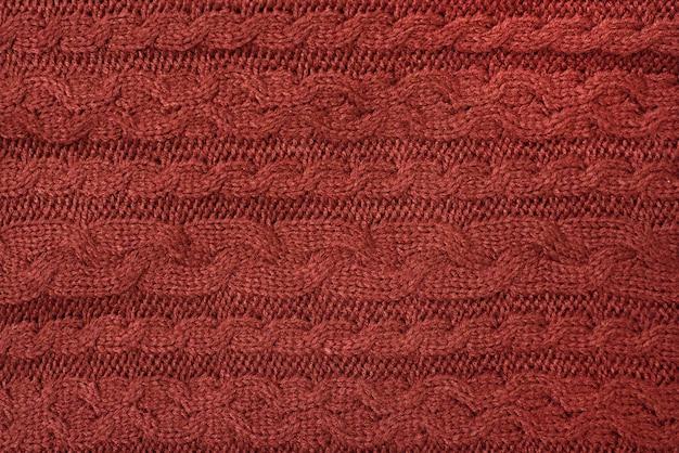Tessuto a maglia marrone, treccia. sfondo del primo piano