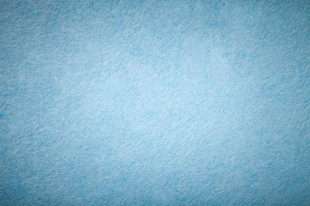 Tessuto azzurro scamosciato opaco trama vellutata di feltro,