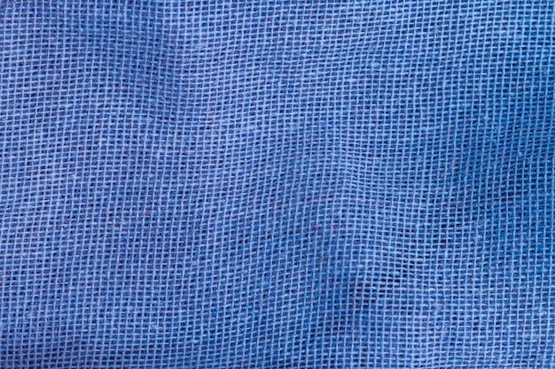 Tessuto blu di struttura del primo piano del vestito