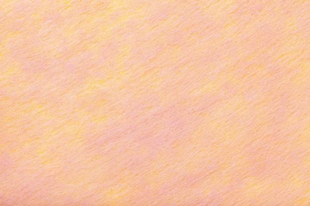 Tessuto corallo chiaro e rosa di feltro. trama di tessuto di lana