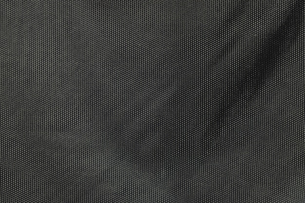 Tessuto del primo piano ai precedenti neri della borsa