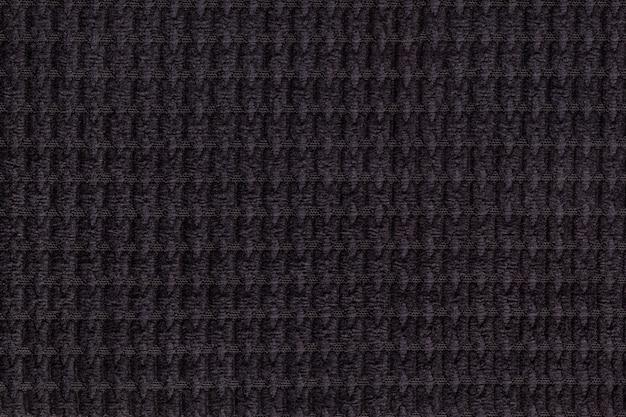 Tessuto morbido nero morbido da vicino.