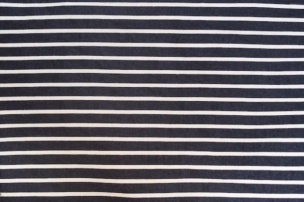 Tessuto nero con strisce bianche senza cuciture.