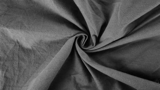 Tessuto nero di seta di cotone texture di sfondo, vecchia trama di abbigliamento sportivo, biancheria da letto in tessuto grigio sporco