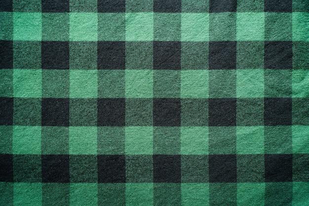 Tessuto nero e verde in una gabbia