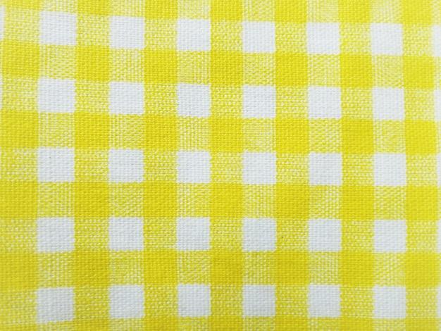 Tessuto plaid giallo semplice per lo sfondo.