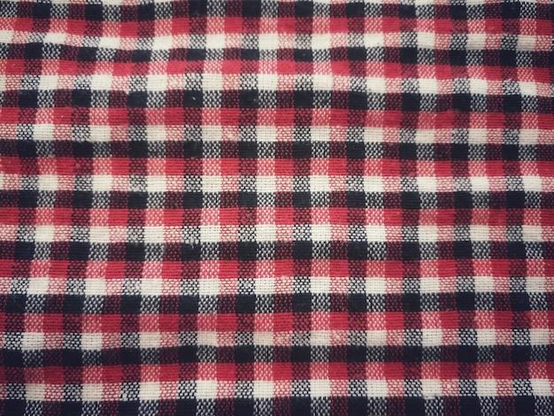 Tessuto plaid rosso, bianco e nero semplice per lo sfondo.