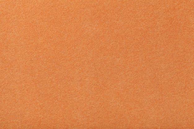 Tessuto scamosciato opaco arancione chiaro trama vellutata di feltro,