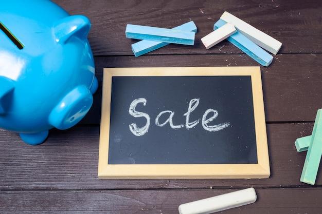 Testo di vendita sulla lavagna