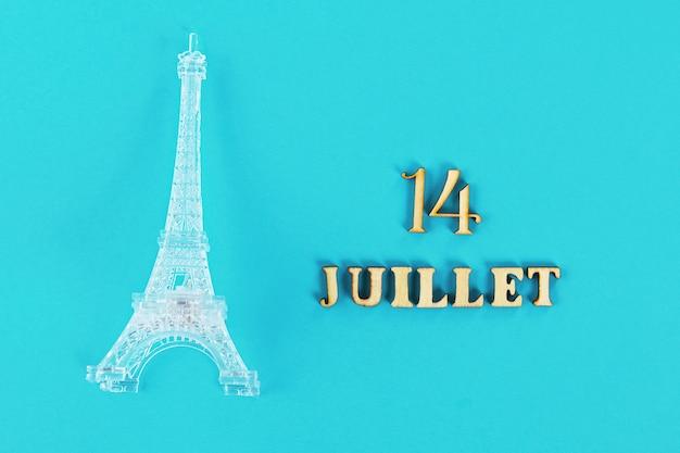 Testo in francese. buon 14 luglio. miniatura della torre eiffel. il giorno della cattura del