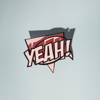 Testo rosa con fumetti comici su sfondo grigio