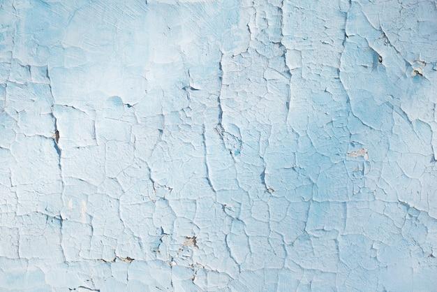 Texture blu con graffi e crepe. sfondo blu. modello blu e bianco