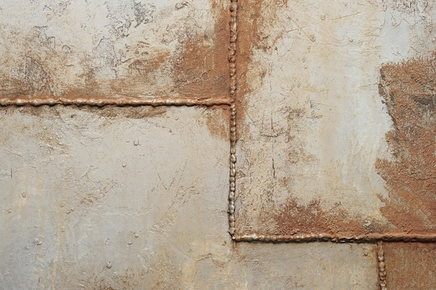 Texture del metallo con cuciture saldate