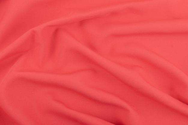 Texture del tessuto opaco rosso corallo
