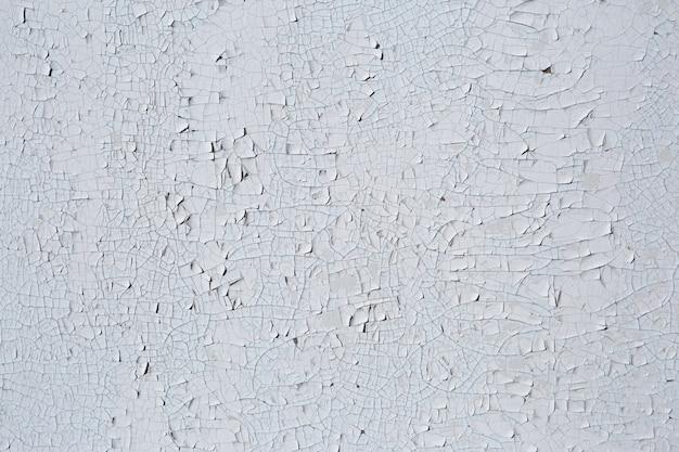 Texture della vecchia pittura ad olio staccata da una superficie in legno