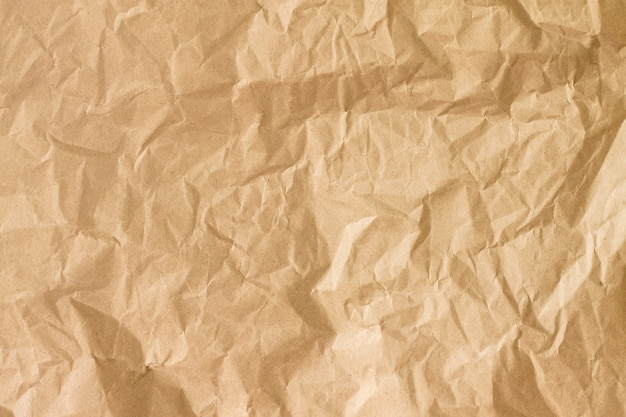 Texture di carta oro stropicciata. carta stropicciata marrone