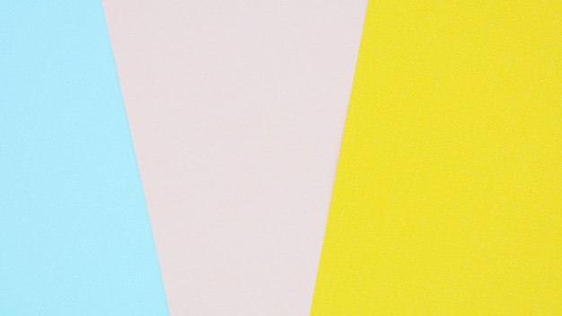 Texture di carta rosa, gialla e blu