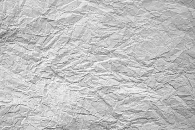 Texture di carta stropicciata bianca. sfondo chiaro, elemento di design.