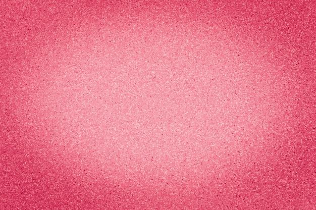 Texture di colore scarlatto di granito con piccoli punti, con vignettatura, utilizzare lo sfondo.