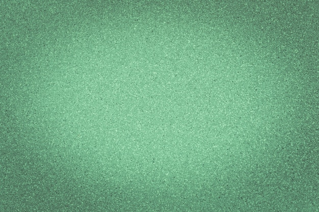 Texture di colore verde granito con piccoli punti, con vignettatura, utilizzare lo sfondo.