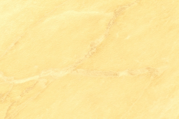 Texture di marmo giallo chiaro con linee dorate