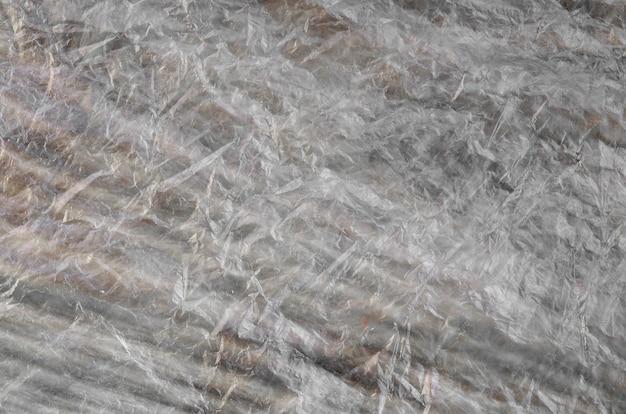Texture di materiale cellophane con molte pieghe e pieghe