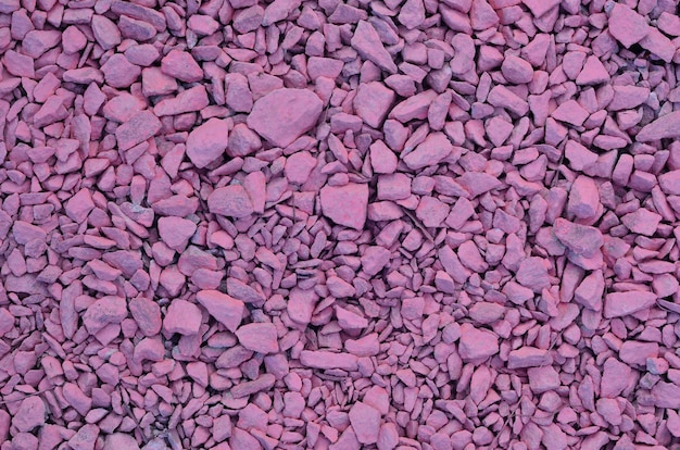 Texture di un mucchio di pietre schiacciate, dipinte in rosa