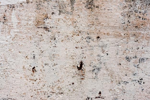 Texture di un muro di cemento con crepe e graffi