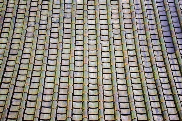 Texture i tetti di tegole verdi.