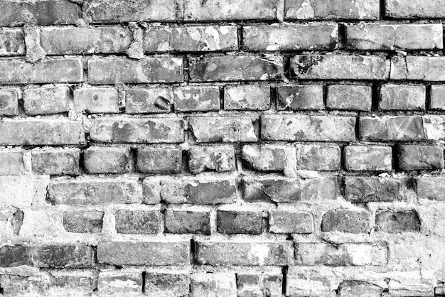 Texture, mattoni, sfondo muro. texture di mattoni con graffi e crepe