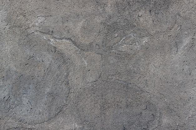 Texture muro di cemento con una crepa.
