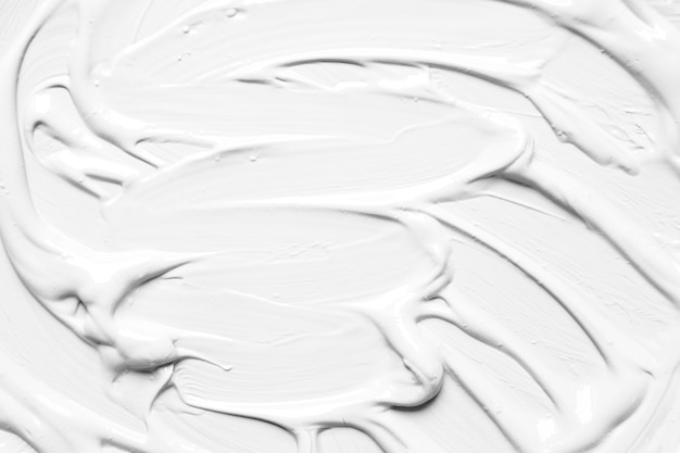 Texture oleosa di vernice bianca in disordine