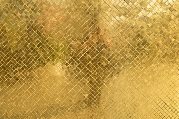 Texure del ricco mosaico dorato da vicino