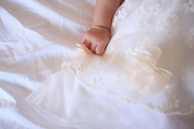 Tiny new born baby hand