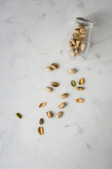 Top view glass with pistachios