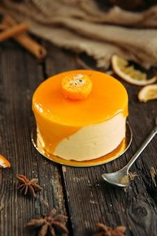 Torta mousse con cheesecake all'arancia e all'arancia