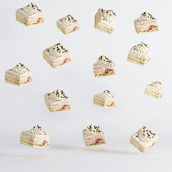 Torte della tazza che galleggiano su fondo bianco. concetto di cibo idea minima.