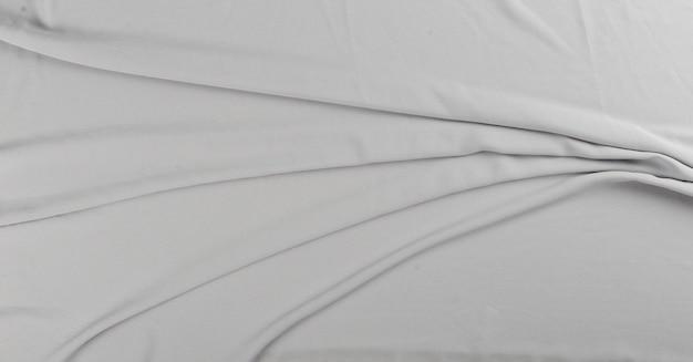 Tovaglia o tessuto strutturato grigio isolato