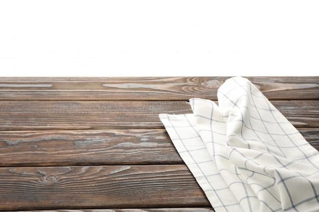 Tovagliolo del tessuto sulla tavola contro fondo bianco, spazio per testo