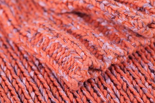 Trama a maglia, prodotto in lana.