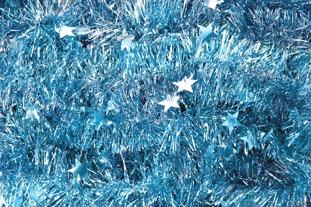 Trama blu tinsel. struttura del nuovo anno sfondo di natale decorazioni