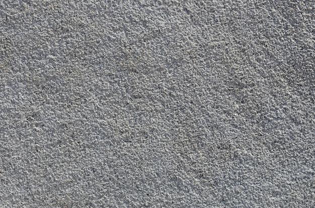 Trama del muro di cemento grezzo con trama in rilievo
