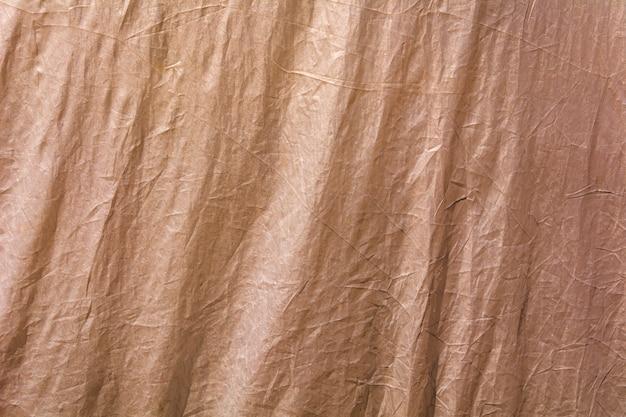 Trama del tessuto marrone come sfondo