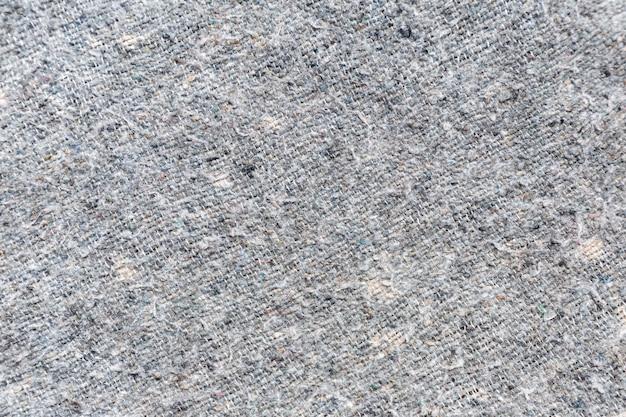 Trama del tessuto o sfondo del tessuto. fabbrica di indumenti di tessuto per il design.