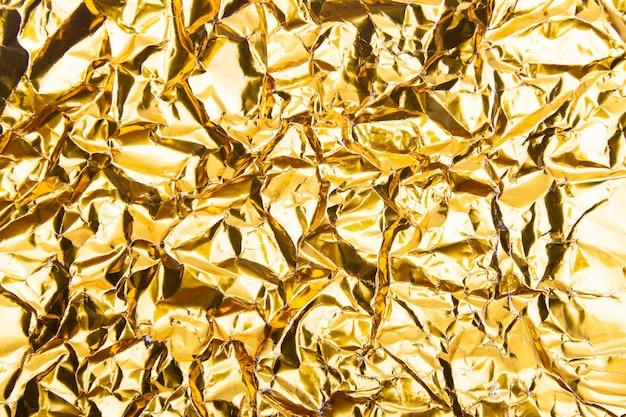 Trama di carta stagnola stropicciata oro.