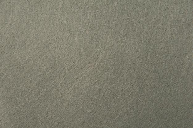 Trama di feltro grigio per lo sfondo