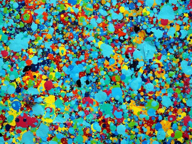 Trama di gocce colorate di pittura. i colori luminosi del fondo astratto artistico spruzza.