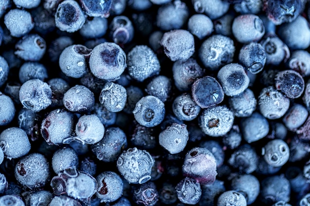 Trama di mirtilli congelati. frutti di bosco congelati