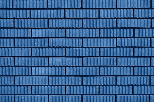 Trama di muro di mattoni sfondo con spazio di copia. colore blu e calmo alla moda.